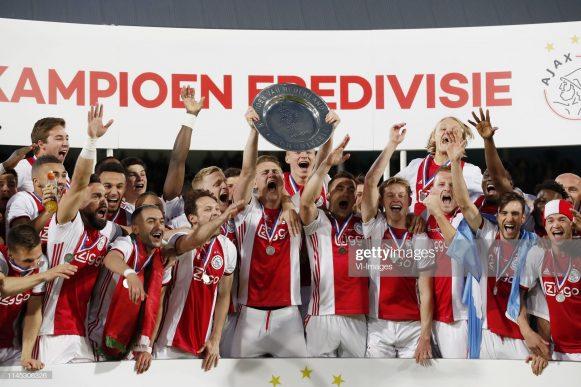 Rasmus Kristensen of Ajax, Joel Veltman of Ajax, Matthijs de Ligt of Ajax, Donny van de Beek of Ajax, David Neres of Ajax, Daley Sinkgraven of Ajax, Klaas Jan Huntelaar of Ajax, Dusan Tadic of Ajax, Noussair Mazraoui of Ajax, Carel Eiting of Ajax, Lisandro Magallan of Ajax, Daley Blind of Ajax, Hassane Bande of Ajax, Zakaria Labyad of Ajax, Lasse Schone of Ajax, Frenkie de Jong of Ajax, Hakim Ziyech of Ajax, Lassina Traore of Ajax, Ajax goalkeeper Andre Onana, Kasper Dolberg of Ajax, Ajax goalkeeper Kostas Lamprou, Perr Schuurs of Ajax, Ajax goalkeeper Bruno Varela, Dani de Wit of Ajax, Nico Tagliafico of Ajax, Vaclav Cerny of Ajax, Ajax goalkeeper Dominik Kotarski, Noa Lang of Ajax, Ryan Gravenberch of Ajax, Jurgen Ekkelenkamp of Ajax, Ajax coach Erik ten Hag, Ajax assistant trainer Alfred Schreuder, Ajax assistant trainer Richard Witschge, Ajax assistant trainer Aron Winter, Ajax team manager Jan Siemerink with the Dutch Eredivisie trophy, dish during the Dutch Eredivisie match between De Graafschap Doetinchem and Ajax Amsterdam at De Vijverberg stadium on May 15, 2019 in Doetinchem, The Netherlands(Photo by VI Images via Getty Images)